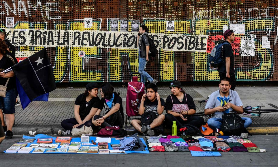 Artists sell merchandise making reference to the social crisis going
