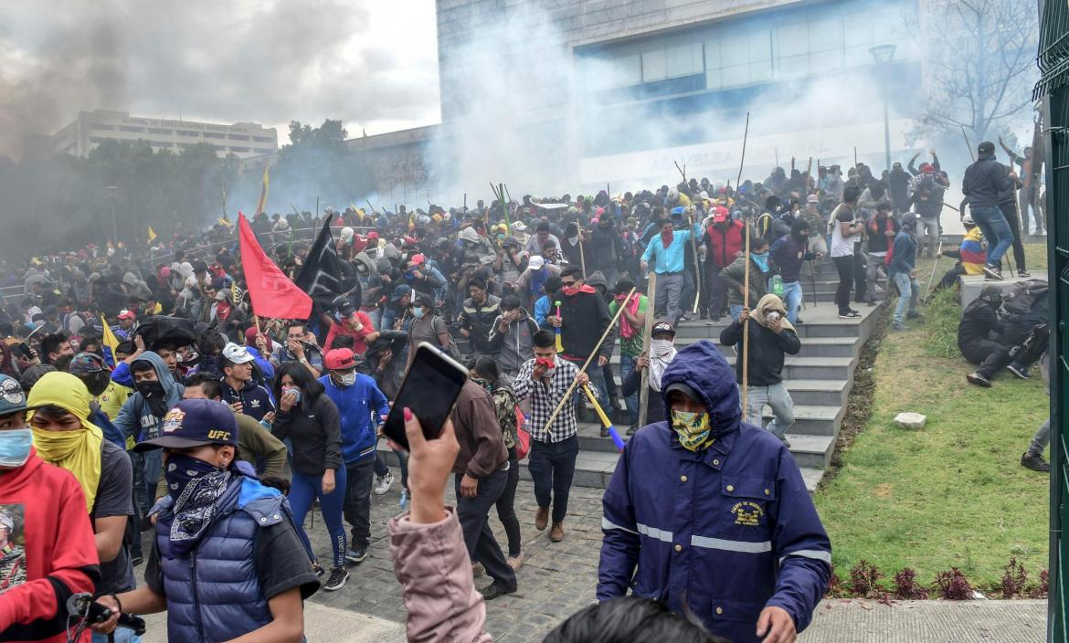 Demonstrators are dispersed away from the national assembly by riot p