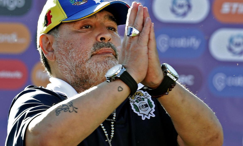 Gimnasia y Esgrima team coach Diego Armando Maradona gestures to supp