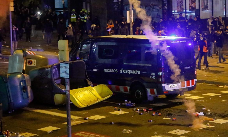 A van of the Catalan regional police 'Mossos d'Esquadra' drives into
