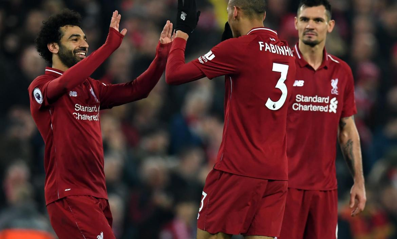 Liverpool's Brazilian midfielder Fabinho (C) celebrates with Liverpoo