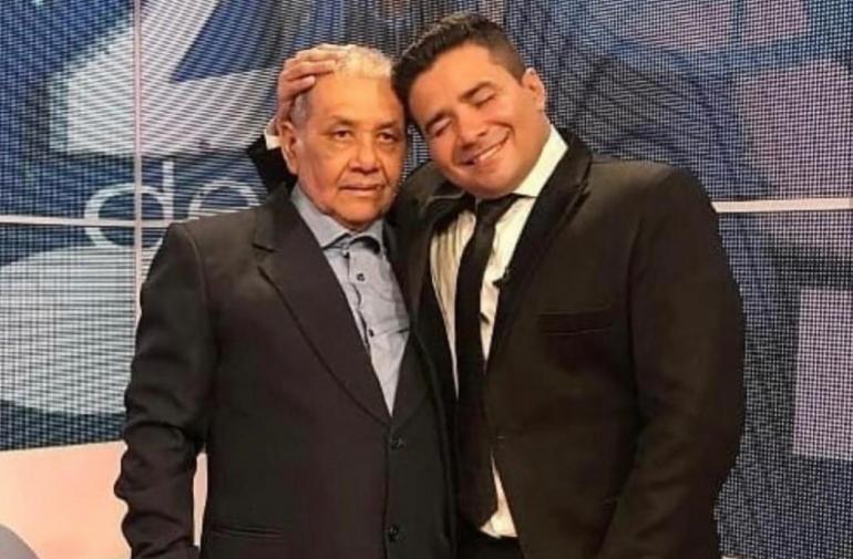 Henry Bustamante con su papá.